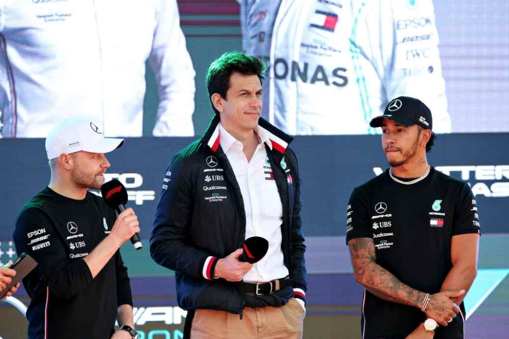 Lewis Hamilton of Great Britain and Mercedes GP, Valtteri Bottas of Finland and Mercedes GP and Mercedes GP Executive Director Toto Wolff talk on stage at the F1 Live event during previews ahead of the F1 Grand Prix of Australia at Melbourne Grand Prix Circuit on March 13, 2019 in Melbourne, Australia.