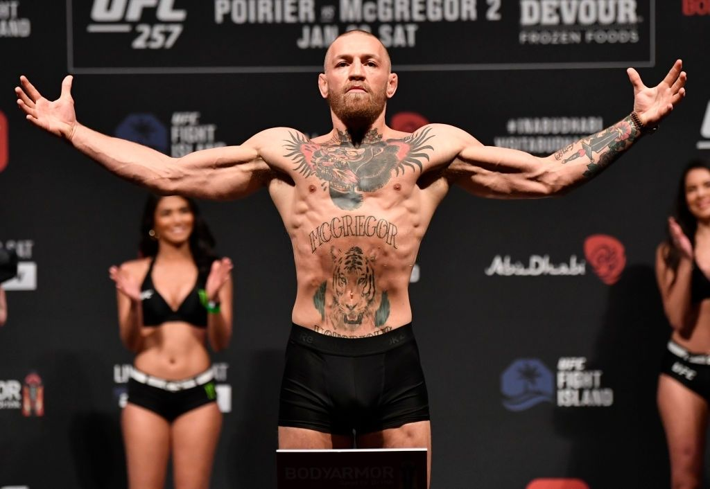 Conor McGregor of Ireland poses on the scale during the UFC 257 weigh-in at Etihad Arena on UFC Fight Island on January 22, 2021