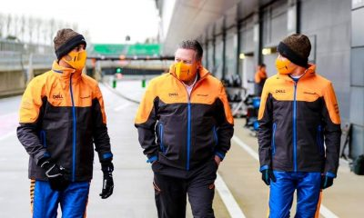 Zak Brown, the McLaren CEO taking a casual walk with McLaren's Formula One drivers.
