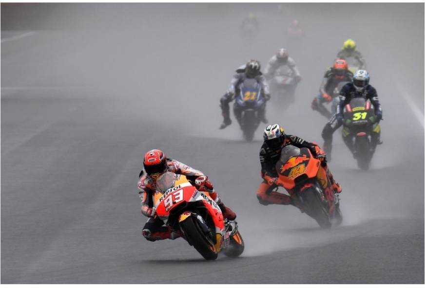 Honda rider Marc Marquez of Spain (front) leads the pack into the first turn during the second practice session of the MotoGP Japanese Grand Prix at Twin Ring Motegi circuit in Motegi,