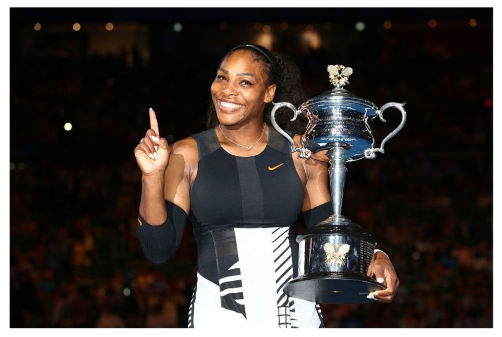Serena Williams poses with the Daphne Akhurst Trophy after winning the Women's Singles Final against Venus Williams of the United States.