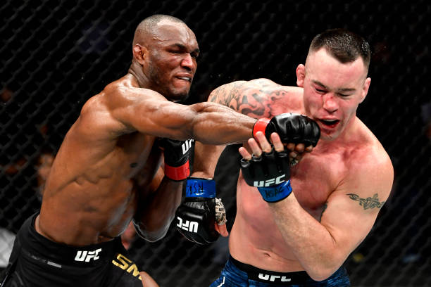 Kamaru Usman of Nigeria strikes Colby Covington in their UFC welterweight championship bout during the UFC 245 event.