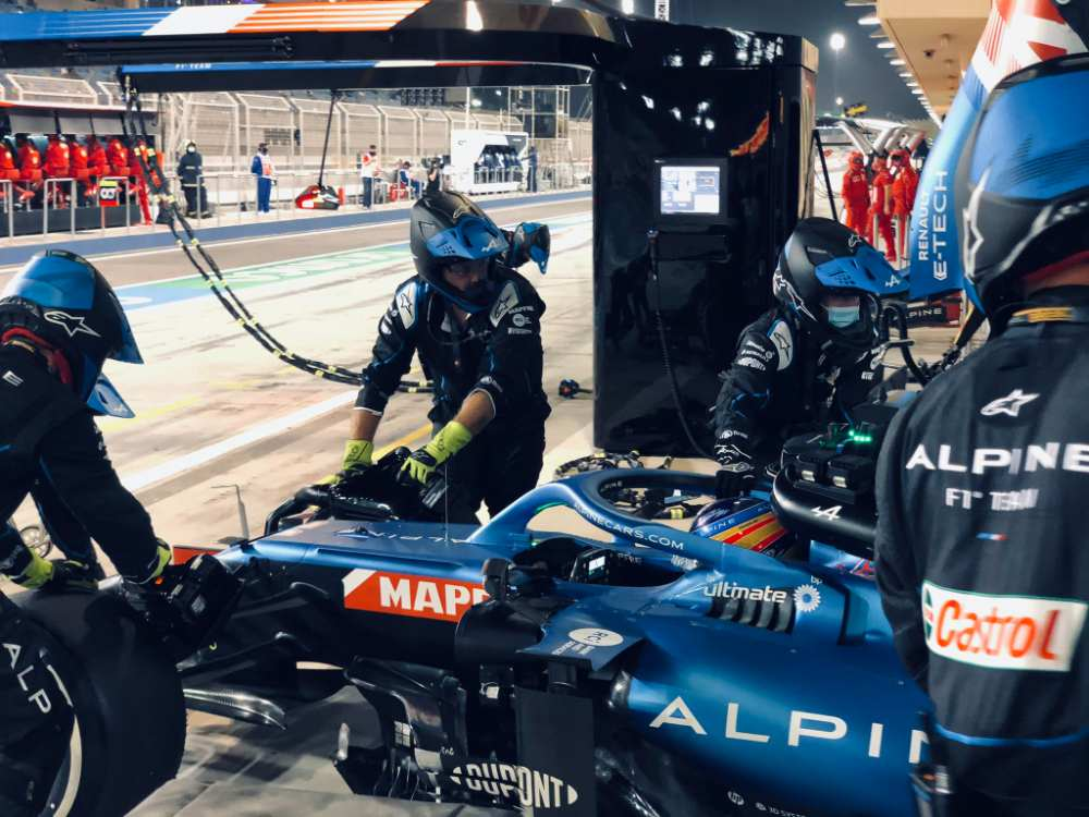 Fernando Alonso is wheeled back to Garage