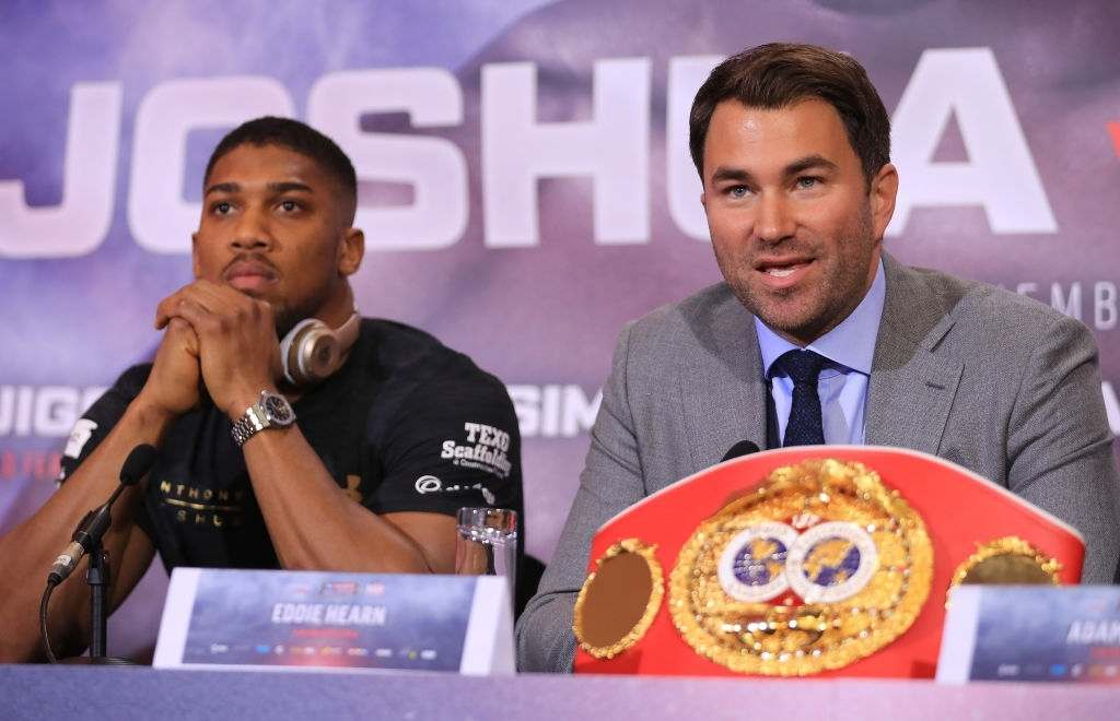 Eddie Hearn, boxing promoter and Anthony Joshua speak during a press conference for his fight against Wladamir Klitschko.