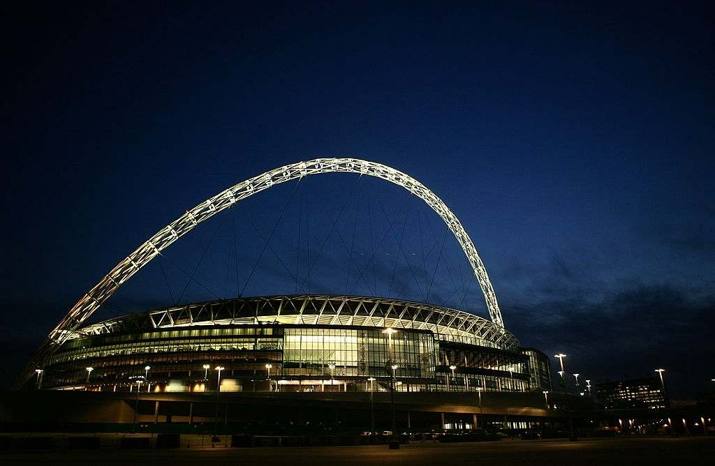 A general view of Wembley Stadium at night in London, England.