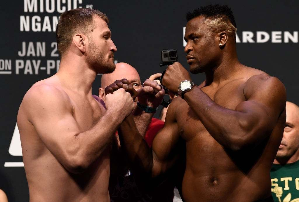 Stipe Miocic and Francis Ngannou of Cameroon face off during the UFC 220 weigh-in