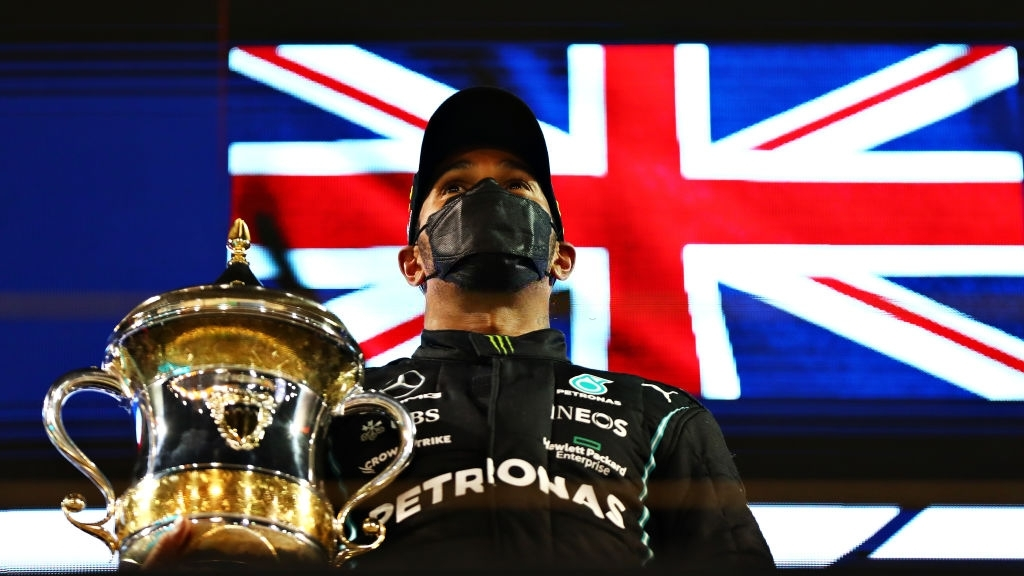 Race winner Lewis Hamilton of Mercedes AMG F1 celebrates on the podium during the Grand Prix at Bahrain International Circuit on March 28, 2021, in Bahrain