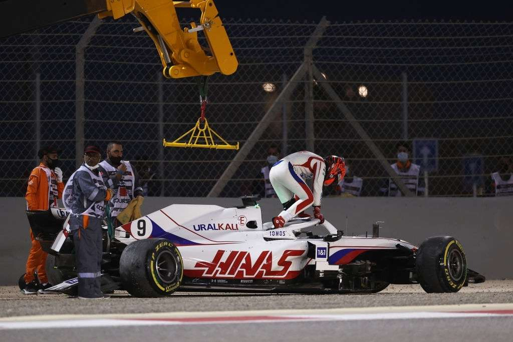 Nikita Mazepin of Russia and Haas F1 climbs out of his car after stopping on track during the F1 Grand Prix of Bahrain at Bahrain International Circuit on March 28, 2021 in Bahrain