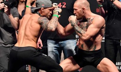 Dustin Poirier and Conor McGregor of Ireland face off during the UFC 257 weigh-in