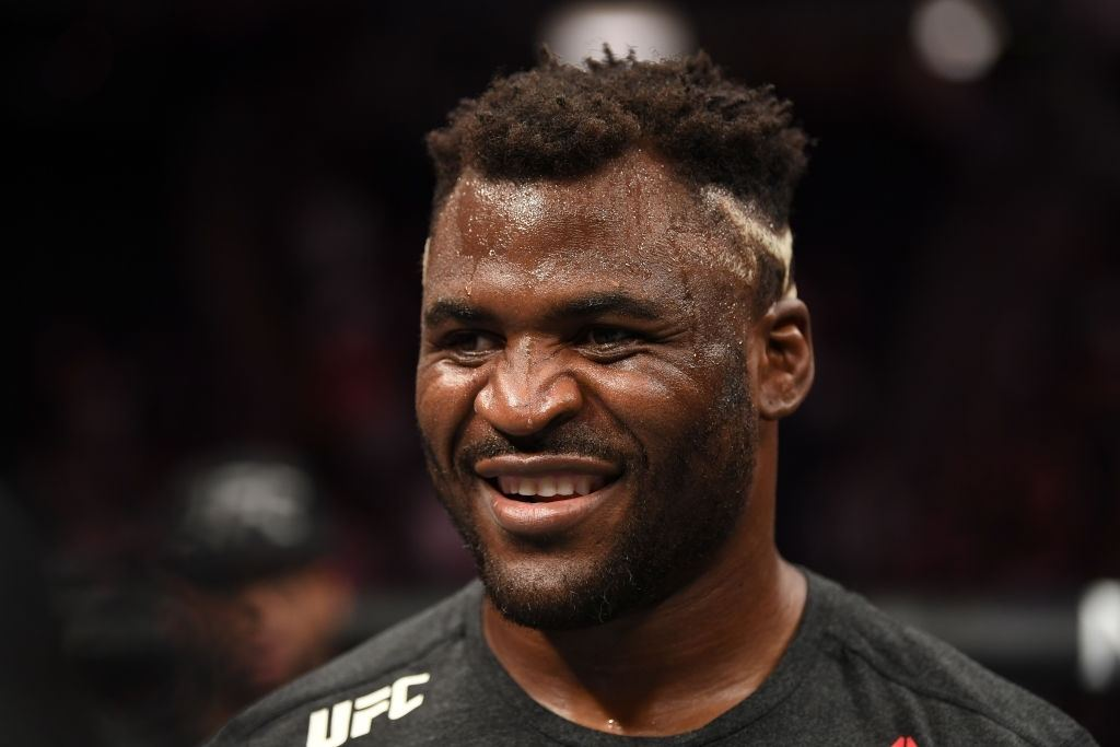 Francis Ngannou of Cameroon celebrates after defeating Junior Dos Santos of Brazil by TKO in their heavyweight bout during the UFC Fight Night event