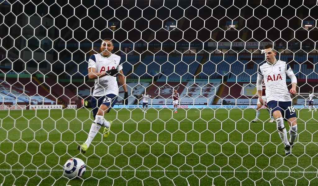 Carlos Vinicius of Tottenham Hotspur scores their side's first goal during the Premier League match between Aston Villa and Tottenham Hotspur at Villa Park on March 21, 2021 in Birmingham, England.