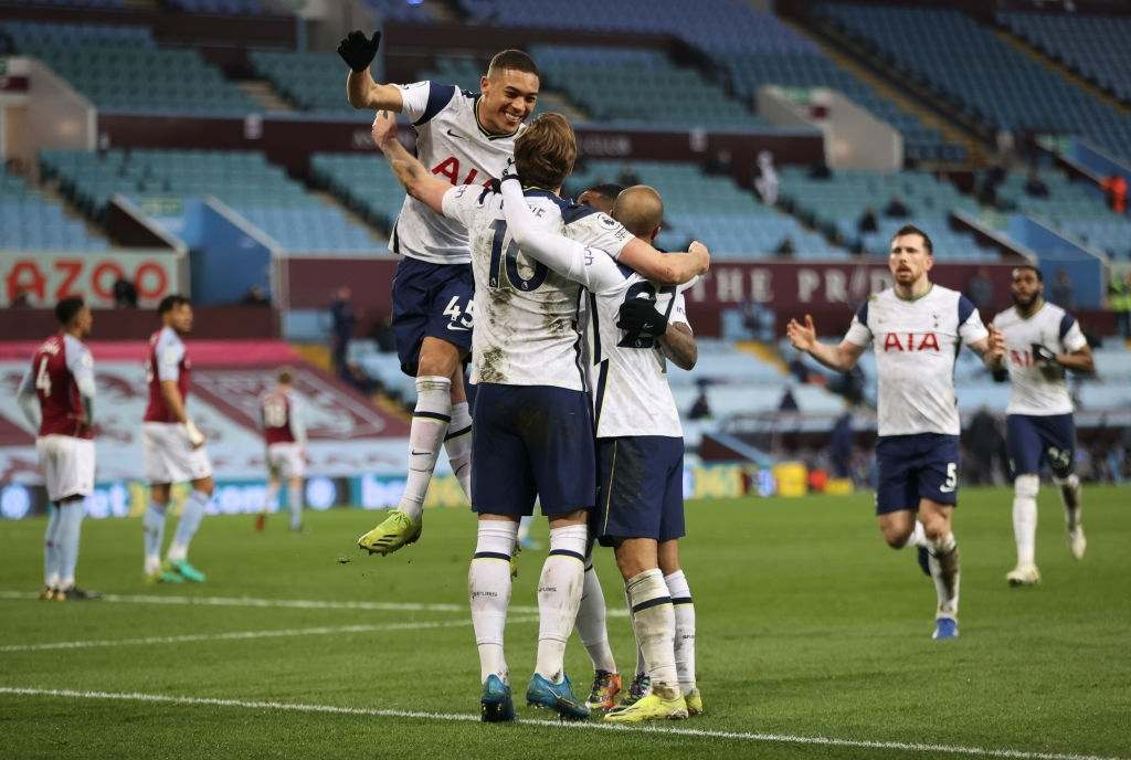 Harry Kane of Tottenham Hotspur celebrates with Carlos Vinicius and Lucas Moura after scoring their side's second goal from the penalty spot during the Premier League match between Aston Villa and Tottenham Hotspur at Villa Park on March 21, 2021 in Birmingham, England.