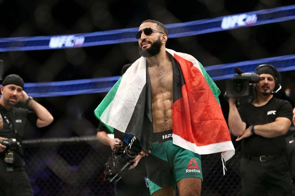 Belal Muhammad celebrates after his victory over Jordan Mein in their welterweight bout during the UFC 213 event