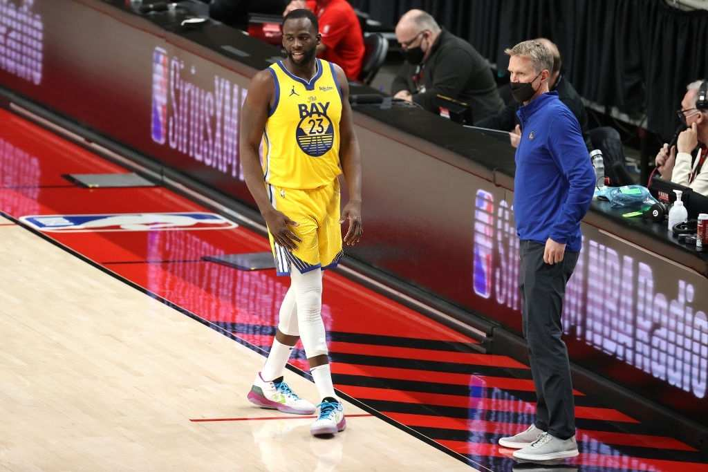Draymond Green #23 and head coach Steve Kerr of the Golden State Warriors have a conversation.