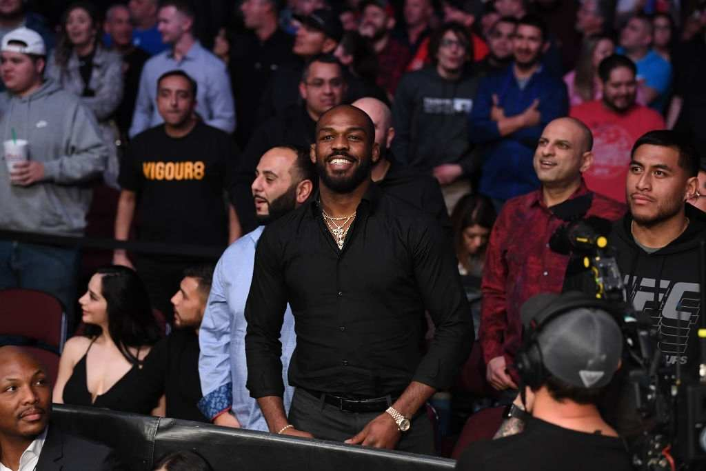 UFC Light Heavyweight Champion Jon Jones looks on after Jan Blachowicz of Poland defeats Corey Anderson by KO in their light heavyweight bout during the UFC Fight Night