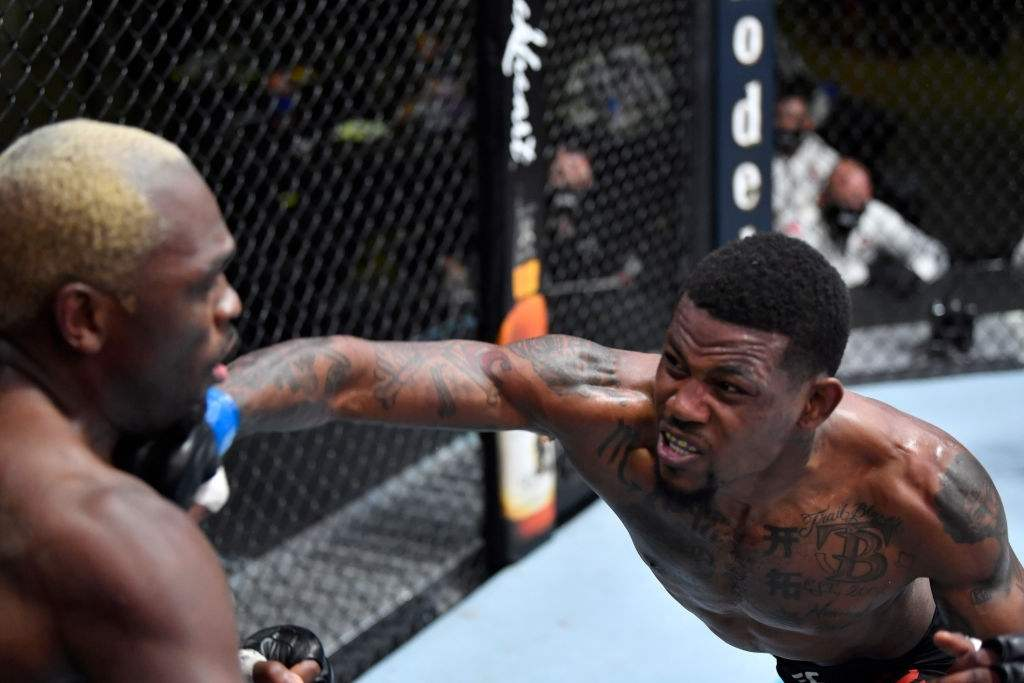 Kevin Holland punches Derek Brunson in their middleweight fight during the UFC Fight Night event at UFC APEX