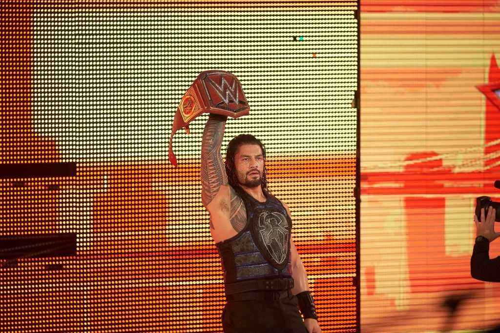 Roman Reigns entering the arena with his belt before Universal Championship match