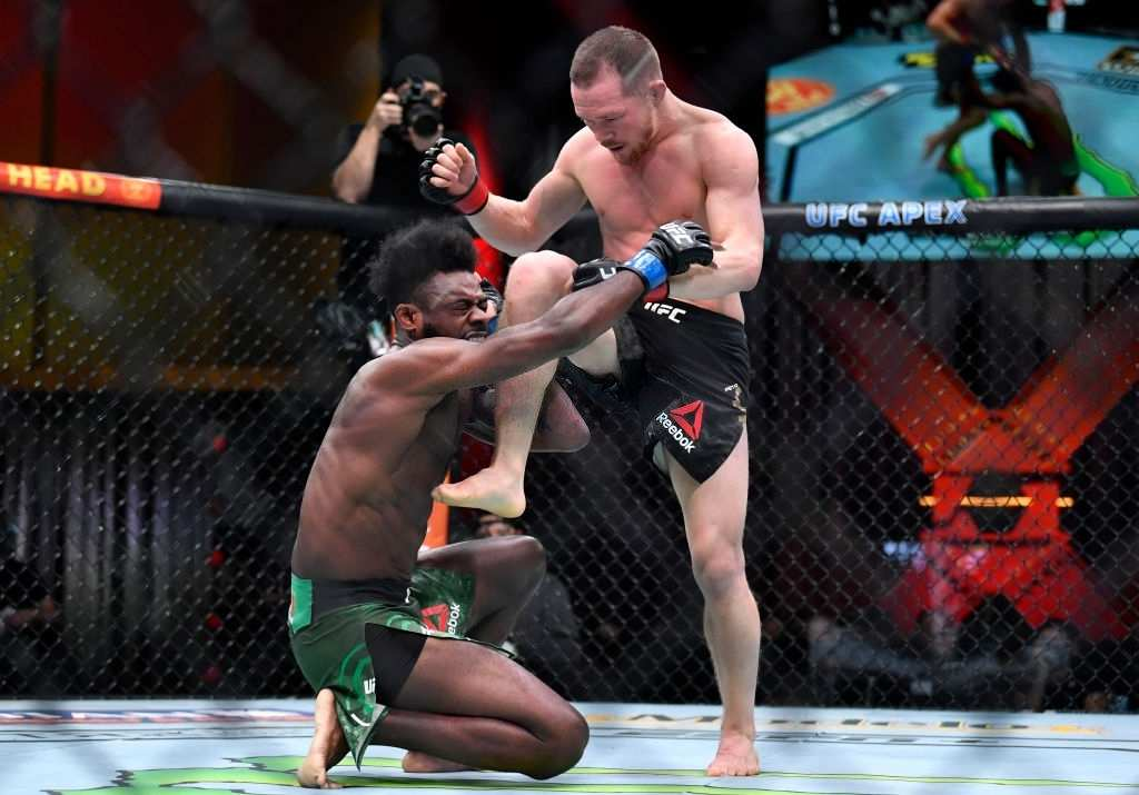 Petr Yan of Russia delivers an illegal knee against Aljamain Sterling