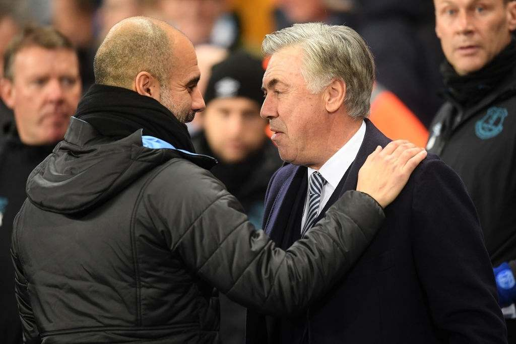 MANCHESTER, ENGLAND - JANUARY 01: Pep Guardiola, Manager of Manchester City embraces Carlo Ancelotti, Manager of Everton ahead of the Premier League match between Manchester City and Everton FC at Etihad Stadium on January 01, 2020 in Manchester, United Kingdom. (Photo by Michael Regan/Getty Images)