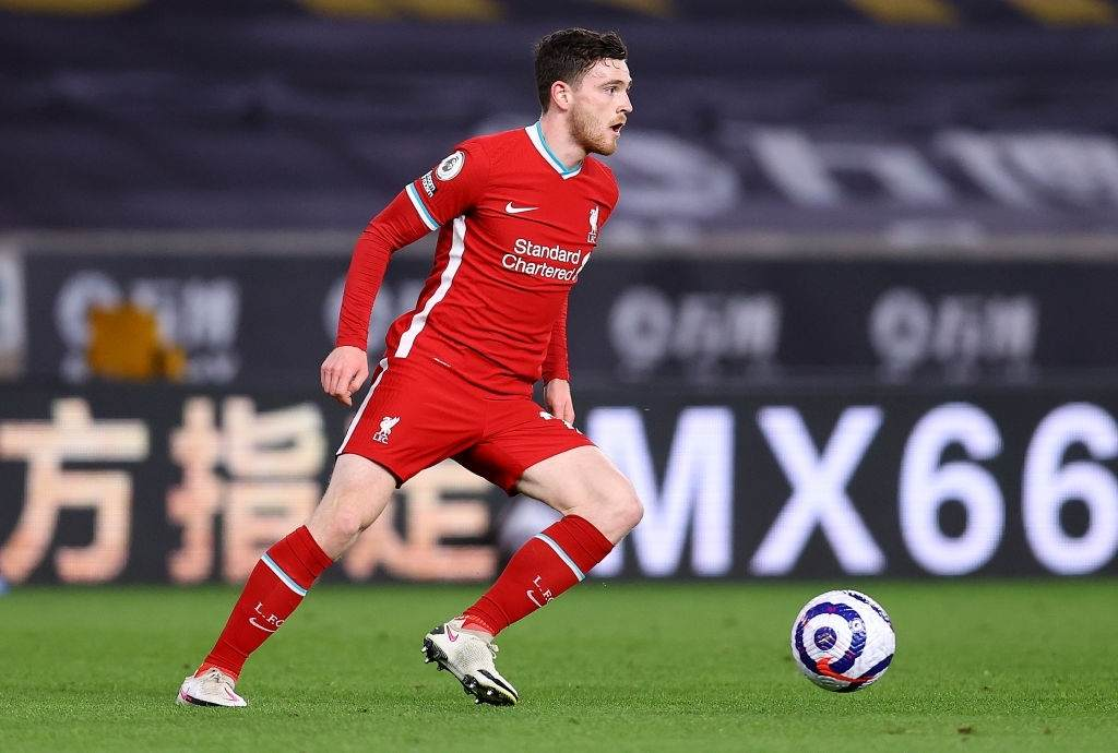 Andy Robertson of Liverpool runs with the ball (Photo by Jack Thomas - WWFC/Wolves via Getty Images)