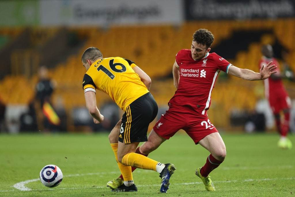 Conor Coady of Wolverhampton Wanderers and Diogo Jota of Liverpool (Photo by Matthew Ashton - AMA/Getty Images)