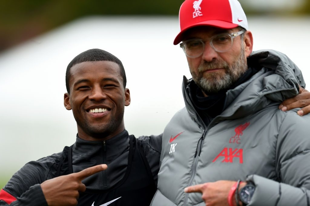 Jurgen Klopp manager of Liverpool with Georginio Wijnaldum of Liverpool (Photo by Andrew Powell/Liverpool FC via Getty Images)