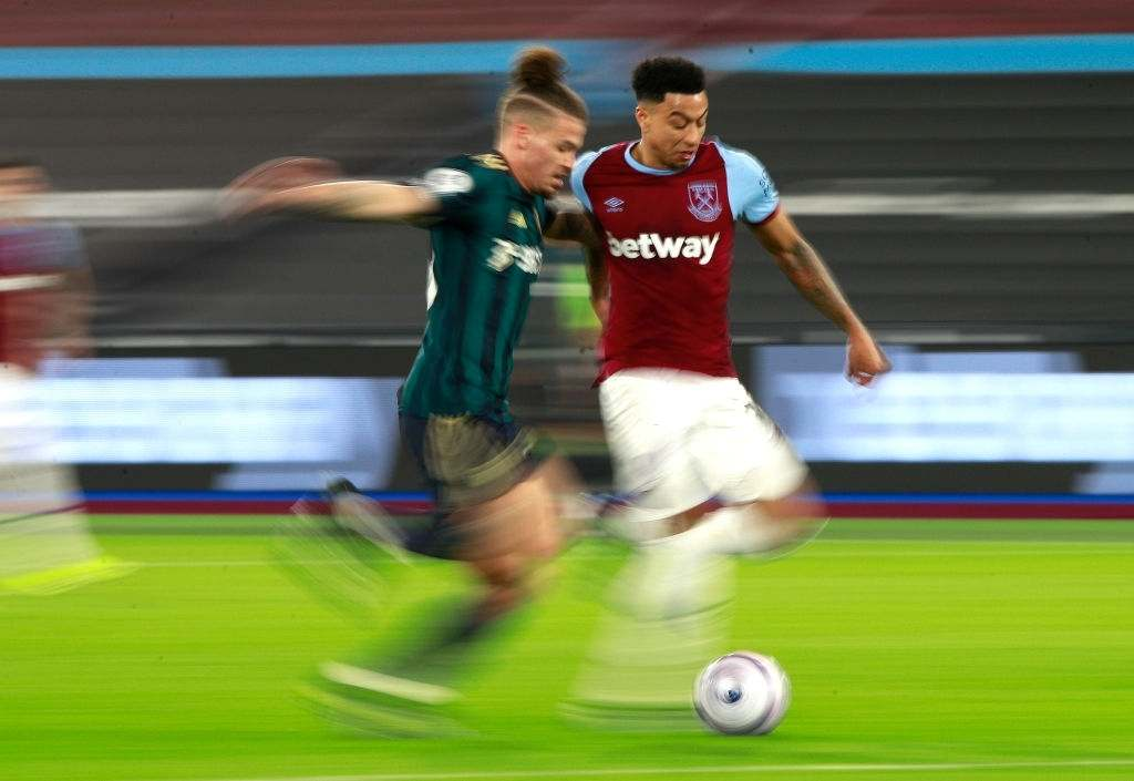 Jesse Lingard of West Ham United is challenged by Kalvin Phillips of Leeds United (Photo by Ian Walton - Pool/Getty Images)