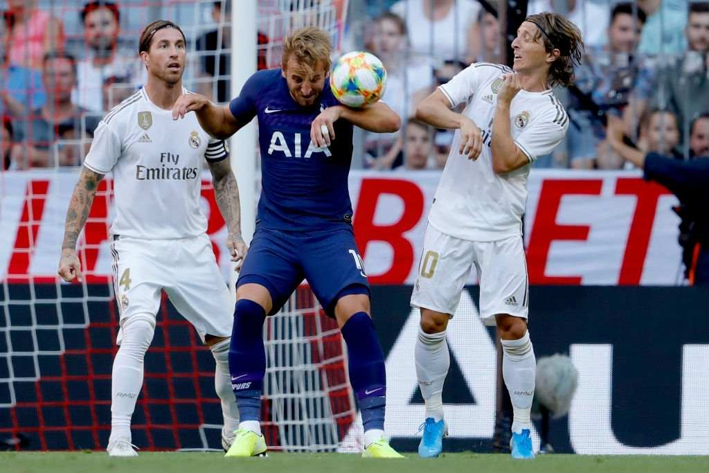 Harry Kane of Tottenham Hotspur, Luka Modric of Real Madrid (Photo by Rico Brouwer/Soccrates/Getty Images)