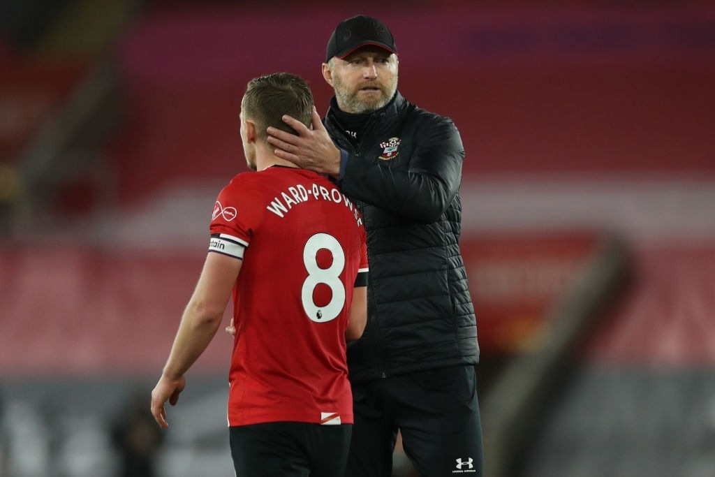 Ralph Hasenhuttl (R) consoles Southampton's James Ward-Prowse (L) (Photo by NAOMI BAKER/POOL/AFP via Getty Images)