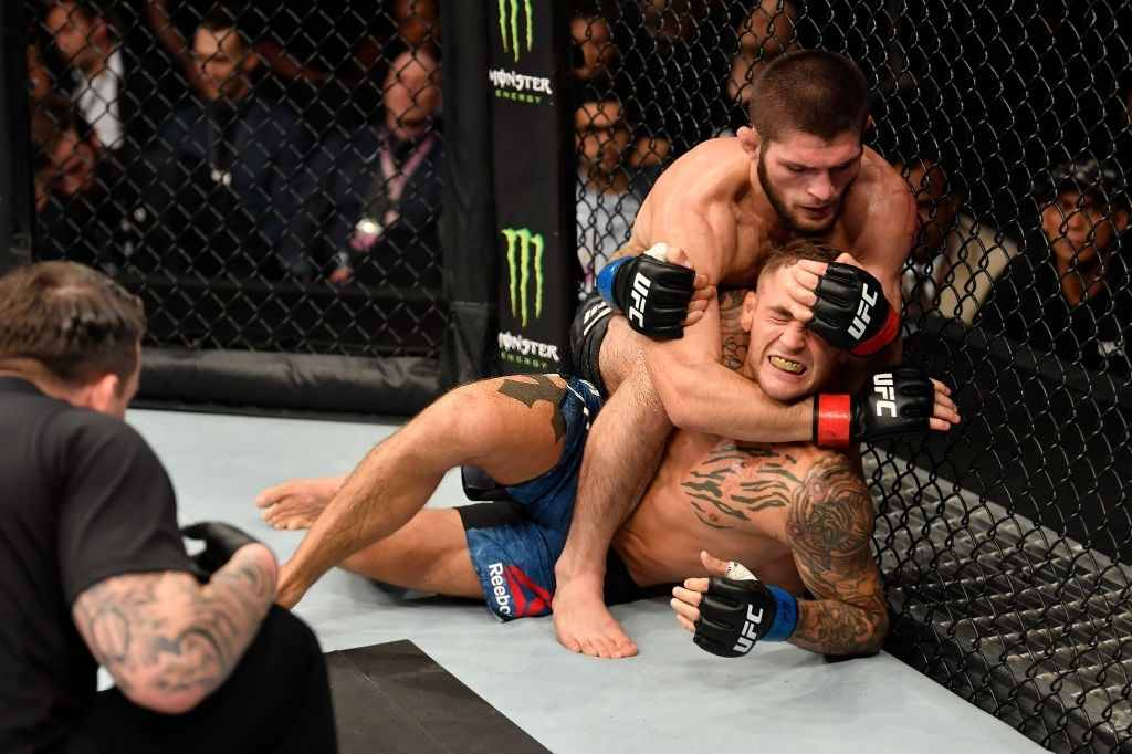 Khabib Nurmagomedov of Russia (top) attempts to submit Dustin Poirier in their lightweight championship bout during UFC 242