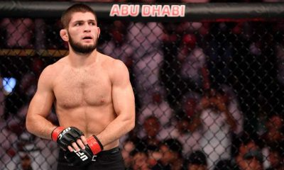 Khabib Nurmagomedov of Russia stands in his corner between rounds of his lightweight championship bout against Dustin Poirier during UFC 242
