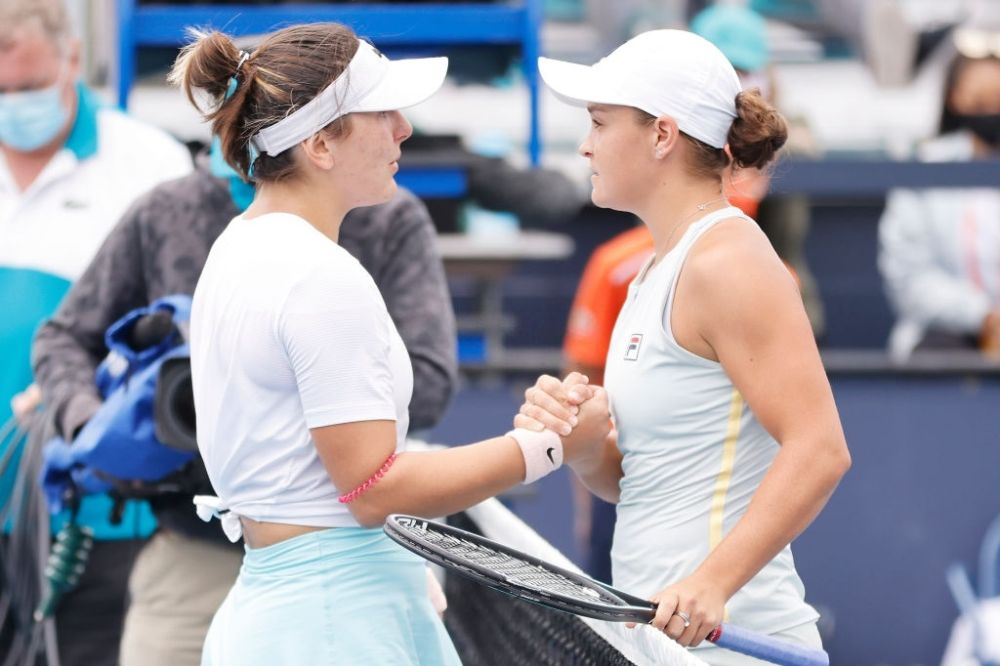 Bianca Andreescu and Ashleigh Barty shake hands.