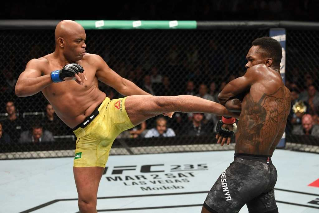 Anderson Silva of Brazil kicks Israel Adesanya of New Zealand in their middleweight bout during the UFC 234 at Rod Laver Arena