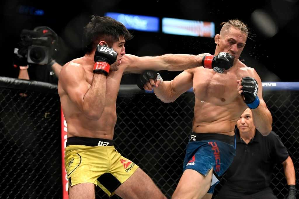 Vicente Luque (L) of the United States punches Niko Price (R) of the United States in their Welterweight fight during UFC 249