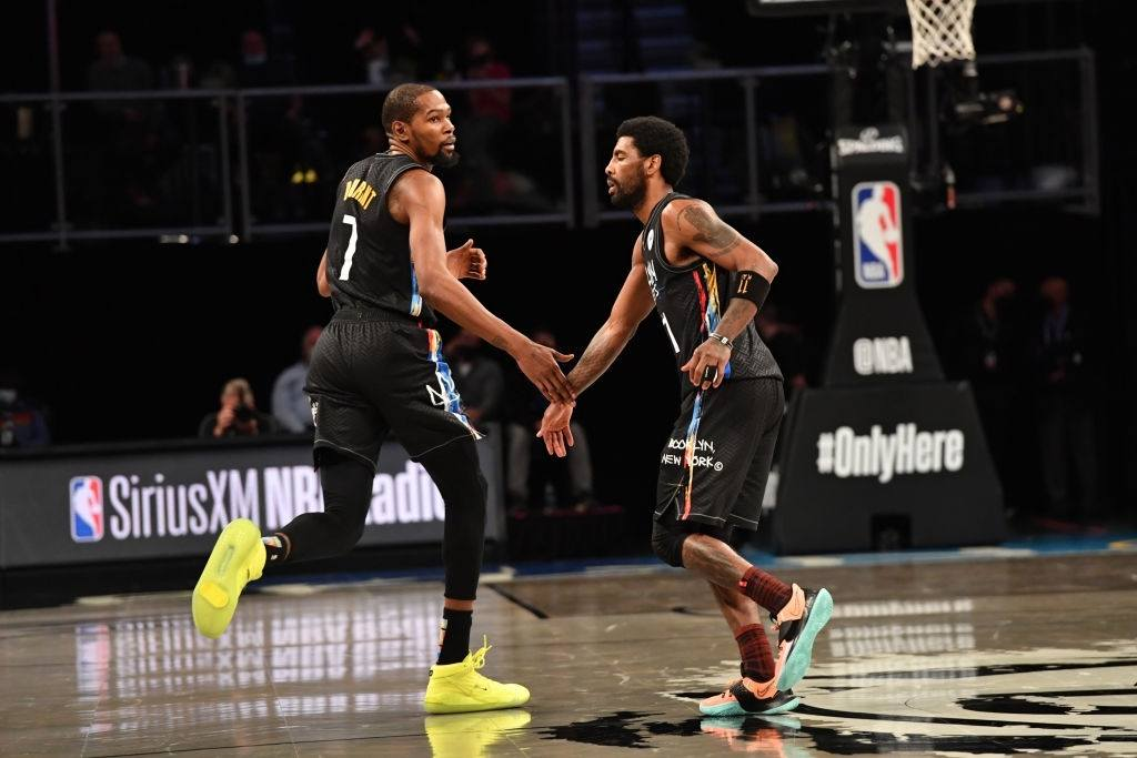 Kevin Durant #7 of the Brooklyn Nets and Kyrie Irving #11 of the Brooklyn Nets high-five during a game against the New Orleans Pelicans.
