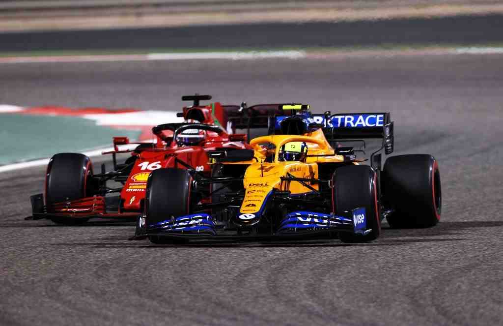 Lando Norris of Great Britain driving the (4) McLaren F1 Team MCL35M Mercedes leads Charles Leclerc of Monaco driving the (16) Scuderia Ferrari SF21 during the F1 Grand Prix of Bahrain at Bahrain International Circuit on March 28, 2021 in Bahrain, Bahrain.