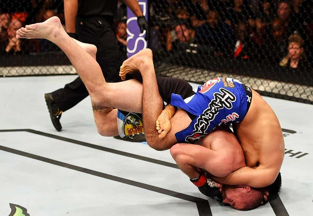 Beneil Dariush of Iran takes down Jim Miller in their lightweight bout during the UFC Fight Night event at Prudential Center on April 18, 2015 in Newark, New Jersey.