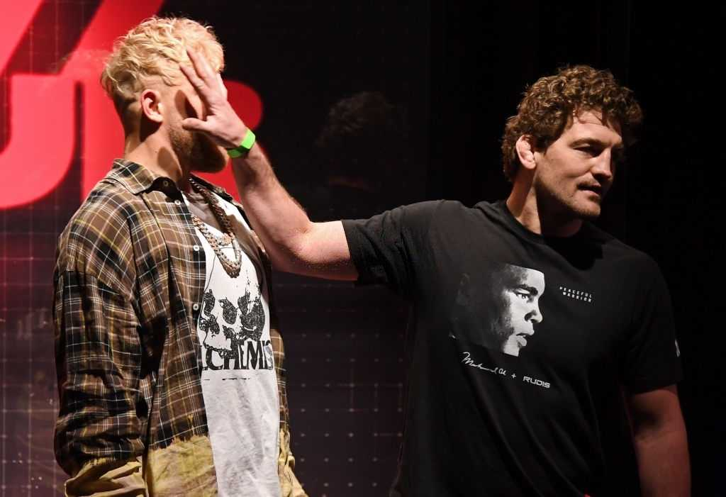 Ben Askren (R) shoves Jake Paul as they face off during a news conference for Triller Fight Club's inaugural 2021 boxing event