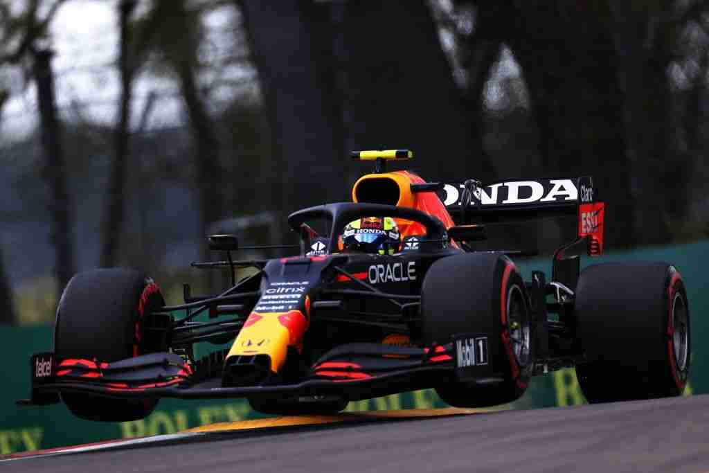 Sergio Perez driving the (11) Red Bull Racing RB16B Honda launches off a raised kerb during qualifying ahead of the F1 Grand Prix of Emilia Romagna at Autodromo Enzo e Dino Ferrari on April 17, 2021 in Imola, Italy.