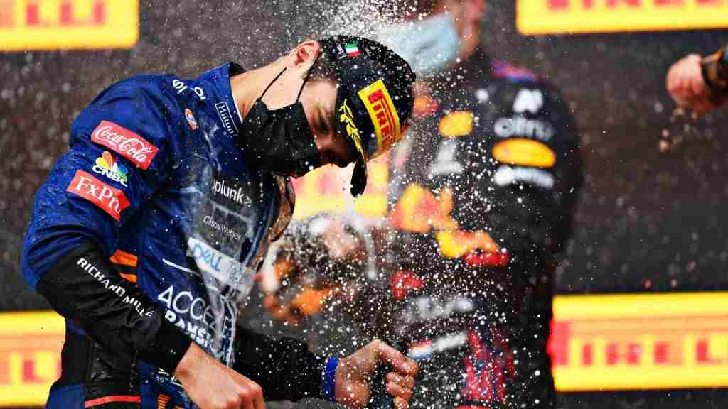 Third placed Lando Norris of McLaren F1 celebrates on the podium with sparkling wine during the F1 Grand Prix of Emilia Romagna at Autodromo Enzo e Dino Ferrari on April 18, 2021 in Imola, Italy.