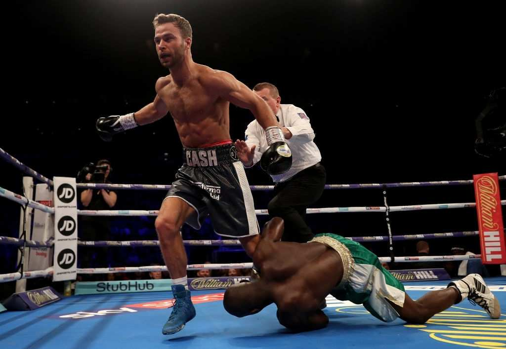 Felix Cash knocks down Rasheed Abolaji during the Commonwealth Middleweight Championship title fight between Felix Cash and Rasheed Abolaji at The O2 Arena on February 02, 2019 in London, England.