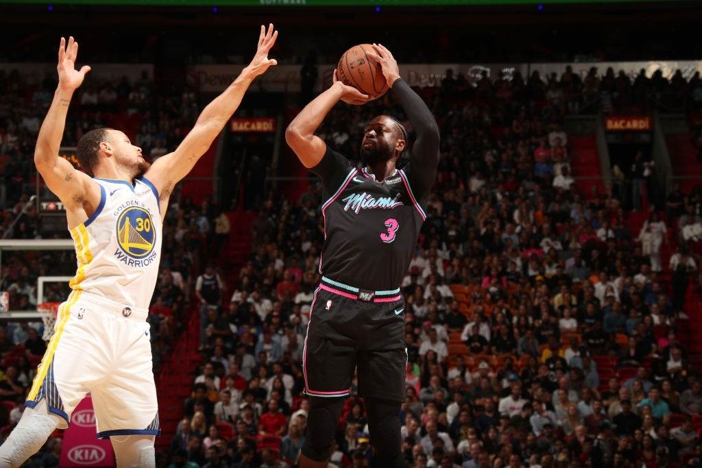 Stephen Curry and Dwayne Wade vie for the ball