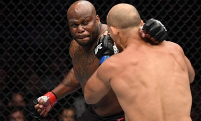 Derrick Lewis punches Junior Dos Santos of Brazil in their heavyweight bout during the UFC Fight Night event at Intrust Bank Arena on March 9, 2019