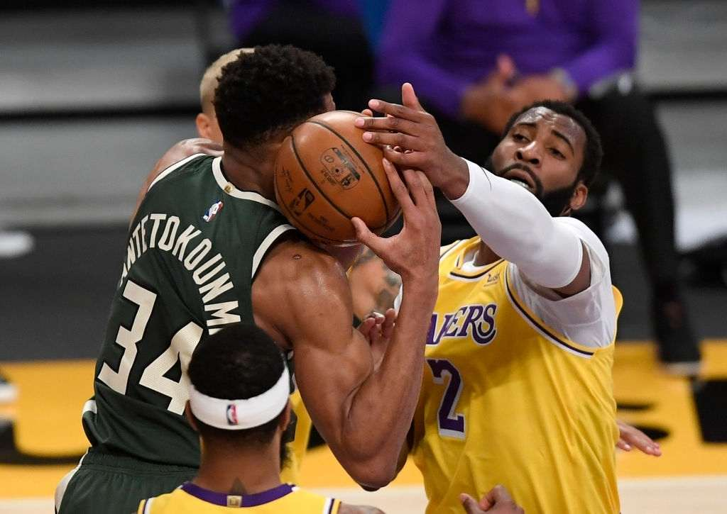 Andre Drummond #2, making his debut with the Los Angeles Lakers, and Giannis Antetokounmpo #34 of the Milwaukee Bucks battle for rebound during the first half