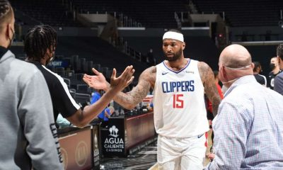 DeMarcus Cousins #15 of the LA Clippers high fives Terance Mann #14 of the LA Clippers after the game against the Portland Trail Blazers on April 6, 2021 at STAPLES Center in Los Angeles,