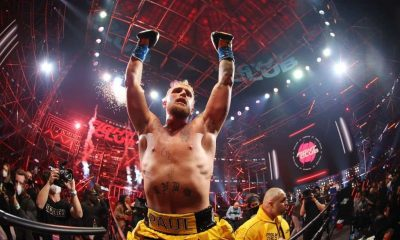 Jake Paul celebrates after defeating Ben Askren in their cruiserweight bout during Triller Fight Club at Mercedes-Benz Stadium