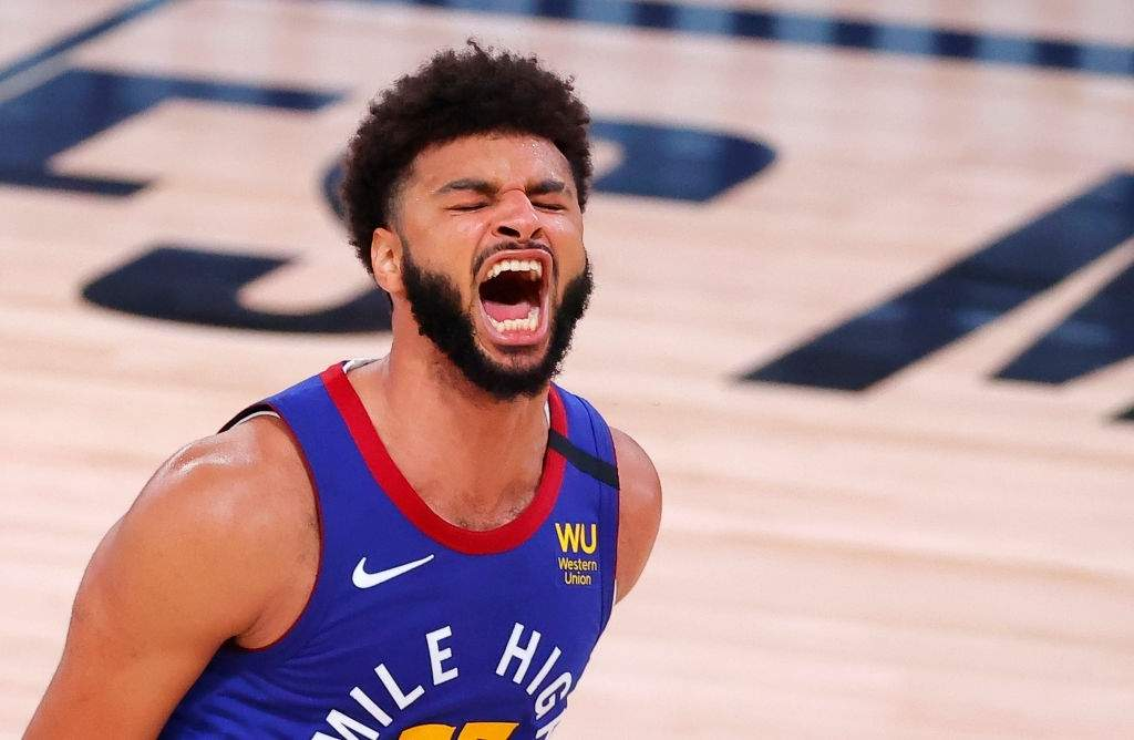 Jamal Murray #27 of the Denver Nuggets reacts as time expires and the Nuggets win