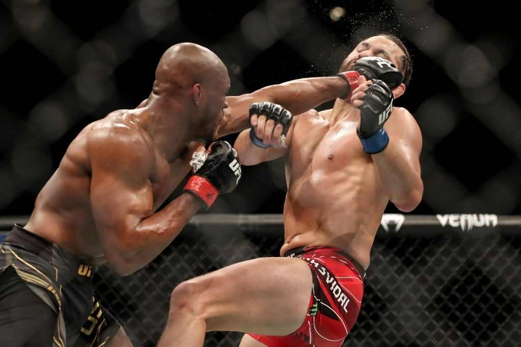 Kamaru Usman of Nigeria punches Jorge Masvidal of the United States during the Welterweight Title bout of UFC 261 at VyStar Veterans Memorial Arena on April 25, 2021 in Jacksonville, Florida.