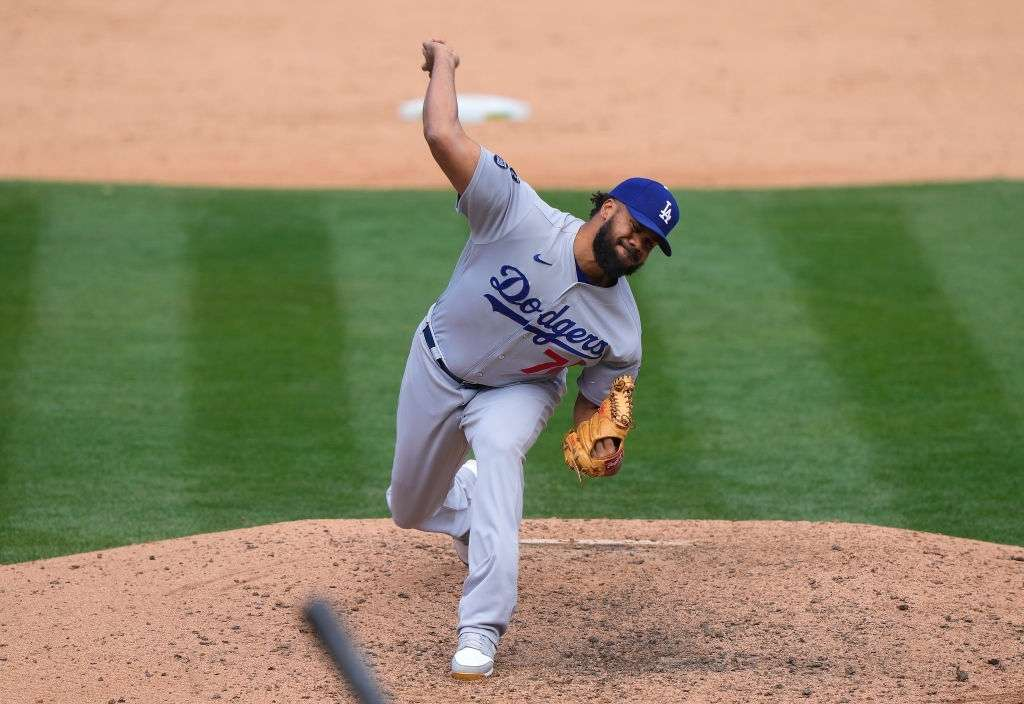 Kenley Jansen #74 of the Los Angeles Dodgers pitches against the Oakland Athletics in the ninth inning