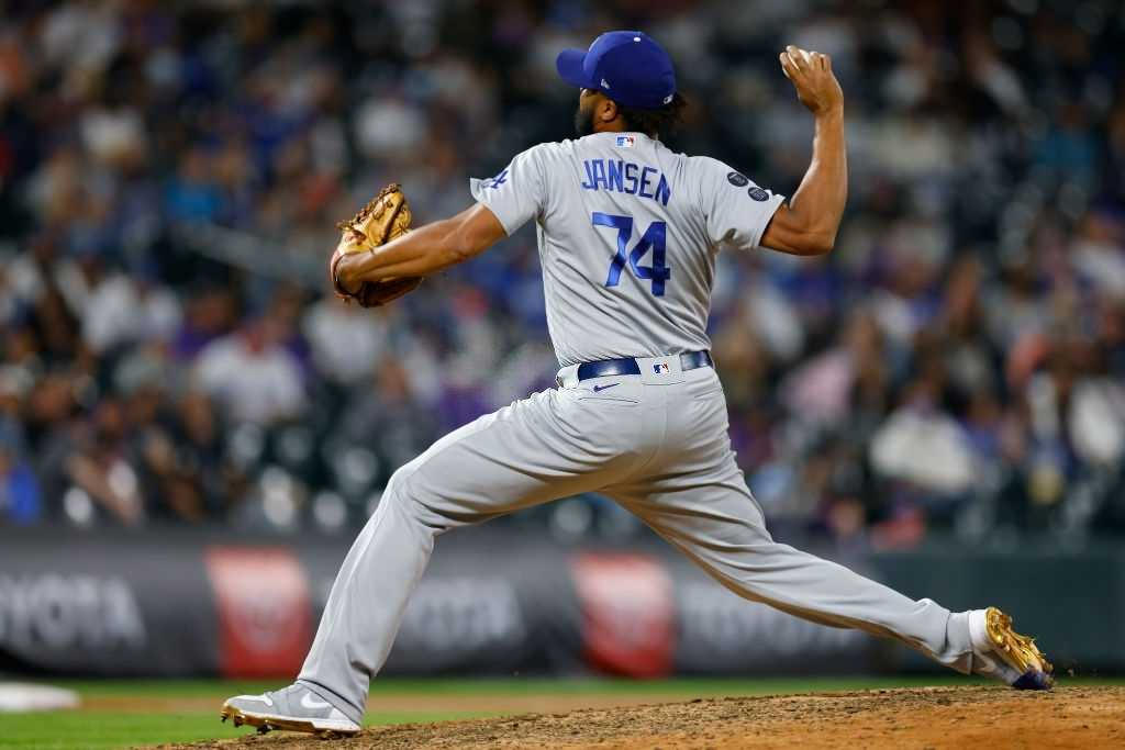 Kenley Jansen #74 of the Los Angeles Dodgers delivers to home plate during the eighth inning against the Colorado Rockies